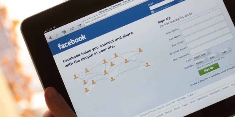 tablet displaying Facebook homepage