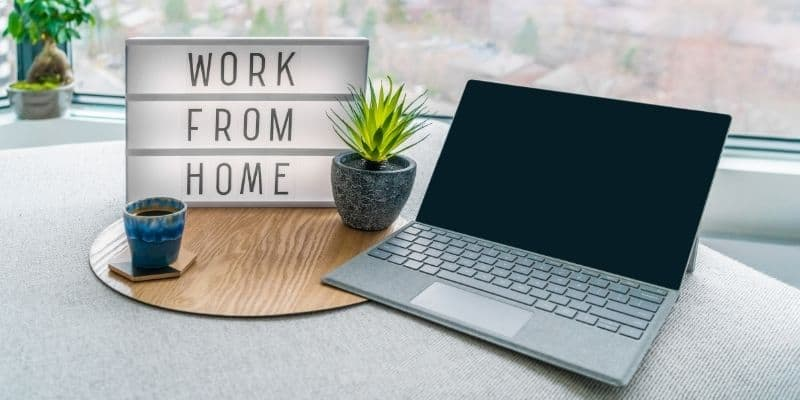 work from home light board sign next laptop on table